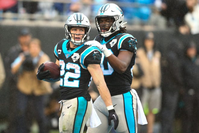 Carolina Panthers running back Christian McCaffrey (22) celebrates a touchdown with tight end Ian Thomas (80). McCaffrey is expected to return to the lineup when the Panthers visit the Kansas City Chiefs at Arrowhead Stadium Sunday.