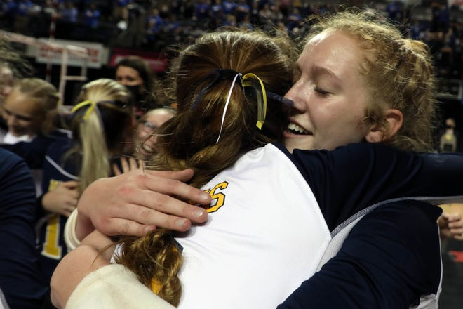 Notre Dame High School's Jenna Bentz (12) hugs teammate Gabby Deery (8) while celebrating their Iowa Class 1A State Volleyball Championship after defeating   Gladbrook-Reinbeck, Thursday Nov. 5, 2020 at the Alliant Energy PowerHouse Arena in Cedar Rapids.