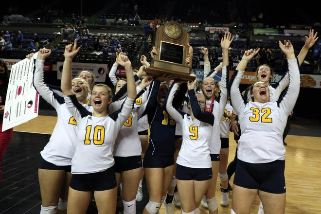 Notre Dame High School players celebrate their Iowa Class 1A State Volleyball Championship after defeating   Gladbrook-Reinbeck, Thursday Nov. 5, 2020 at the Alliant Energy PowerHouse Arena in Cedar Rapids.