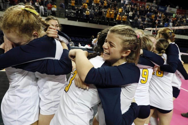 Notre Dame High School's Kerrigan Belger (10) hugs teammate Molly Johnson (13) while celebrating their Iowa Class 1A State Volleyball Championship after defeating   Gladbrook-Reinbeck, Thursday Nov. 5, 2020 at the Alliant Energy PowerHouse Arena in Cedar Rapids.