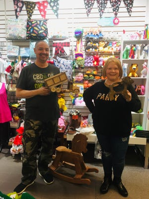 Seacoast Crafters owners Clarence Bowe and Stacey Bowe are collecting for Toys for Tots in 2020.