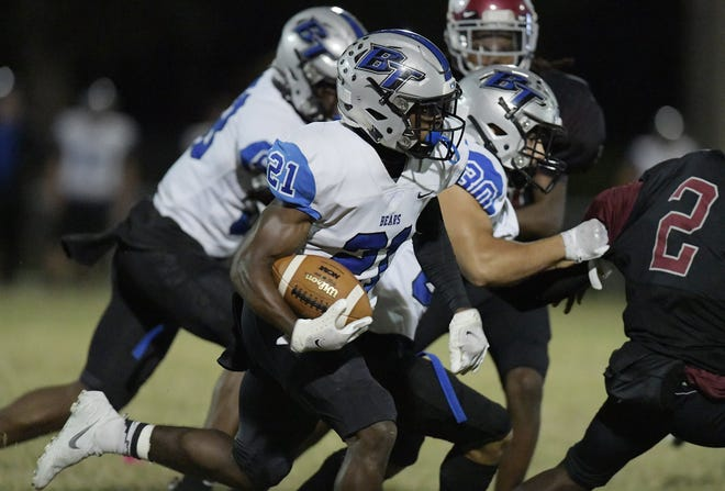 Bartram Trail's Eric Weatherly runs back the opening kickoff of Thursday night's game against Raines. Weatherly gained more than 200 all-purpose yards.
