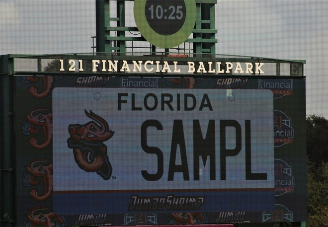 The new Jacksonville Jumbo Shrimp license plate is displayed Friday on the scoreboard at 121 Financial Ballpark.