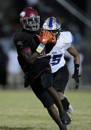 Raines wide receiver Kareem Burke (2) pulls in a long pass in the 2020 regular season finale against Bartram Trail. Spring football begins Monday across Florida high schools.