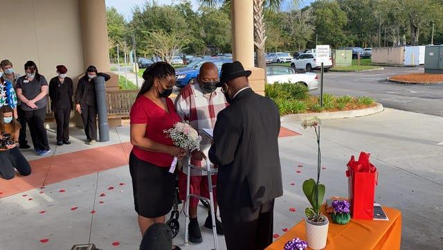 Photos: COVID-19 survivor, fiancee wed outside Florida hospital