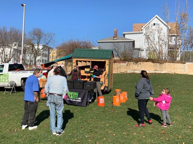 Customers pick up fresh produce from the Montachusett Mobile Market in Gardner on Friday, Nov. 6.