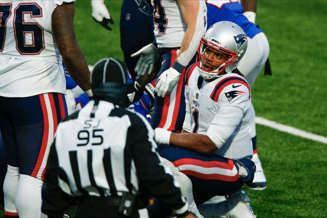 New England Patriots quarterback Cam Newton (1) reacts after fumbling the ball during the final drive of a game against the Buffalo Bills Sunday, Nov. 1, 2020, in Orchard Park, N.Y. The ball was recovered by Dean Marlowe as the Bills won 24-21. (AP Photo/John Munson)