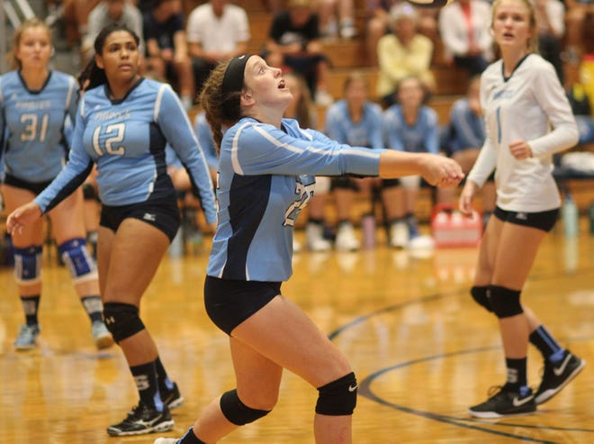 Swansboro's Kimmie Ross prepares to deliver a set during a match last year. [Chris Miller / The Daily News]