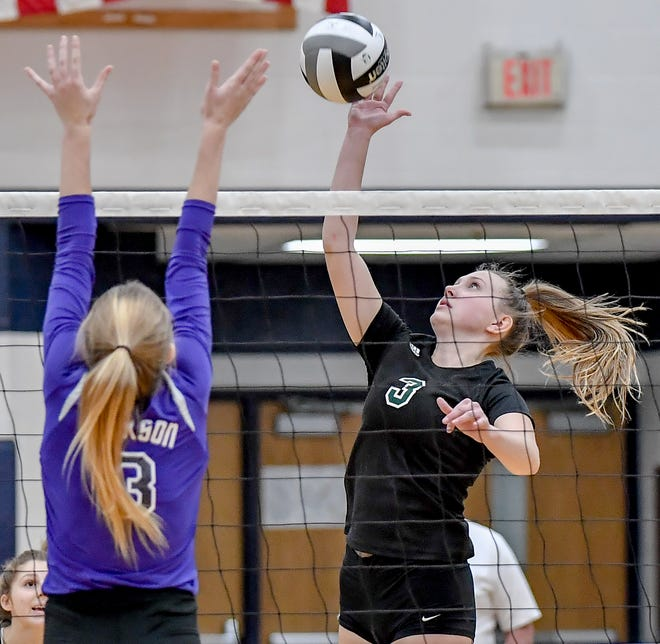 Nordonia senior Faith Sparks puts a kill attempt over Massillon Jackson's Sydney Wake during the Knights' 25-14, 21-25, 25-23, 25-18 loss Nov. 5 in a Division I regional semifinal game at Hudson.