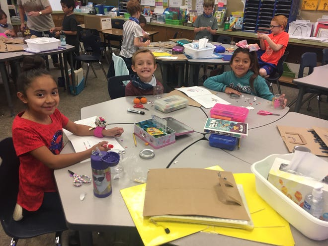 Students in a second-grade class at Frenship's Northridge Elementary work on an arts and crafts project during Thursday's United We Read event.
