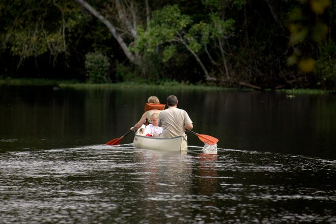 Tourists enjoy the scenery while paddling down the Wekiva River in Wekiwa Springs State Park in 2005. Orange County voters approved a measure Tuesday that grants the Wekiva and Econlockhatchee rivers legal rights. It's at odds with a state law, however, and will likely be decided in courts.