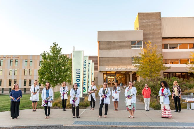 Mount Wachusett Community College students who graduated this past August with their Dental Hygiene associate degree were honored recently during an outdoor, socially distant pinning ceremony at the college's Gardner campus.