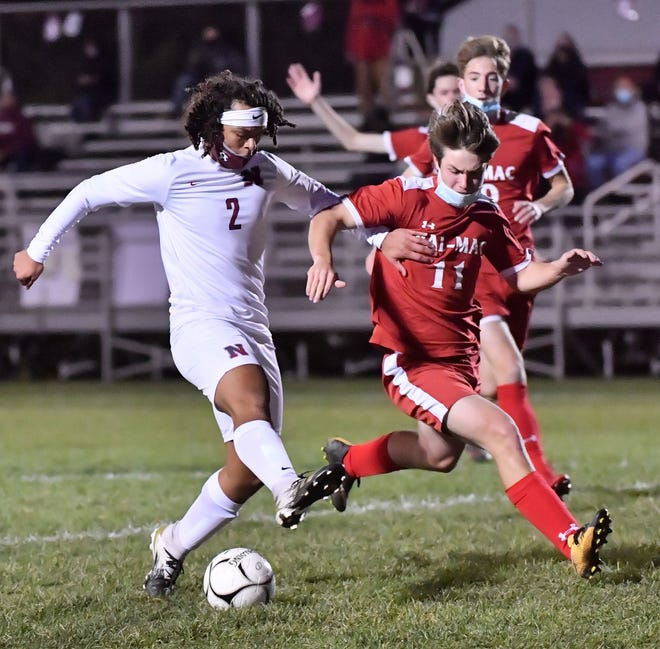 Newark's Addison Bump (2) and Pal-Mac senior Jake McIntyre (11) go for the ball in the first half of Thursday's match.