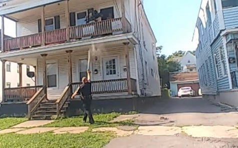 In this screenshot from the Oneida County District Attorney's Office report on an Aug. 23, 2020 incident involving Utica police Sgt. Samuel Geddes, Geddes is seen spraying pepper spray towards a woman and teenager.