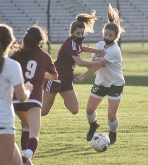 Clinton's Alexa Bohling and a Westmoreland player collide while going for the battle Tuesday during a match. Clinton won 3-0.