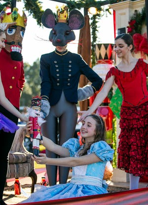 "Clara, played by Ava Crews, holds a ""Nutcracker"" character as part of one of the floats in the 2019 Ocala Christmas Parade. This year's parade depends on the Ocala City Council issuing a permit for the event in the midst of the COVID-19 pandemic."