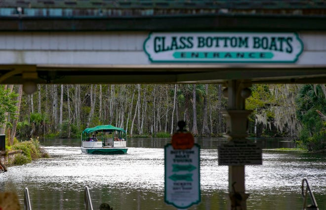 A glass-bottom boat returns to the dock on Nov. 5. The park will be getting a boat that is accessible for wheelchairs.