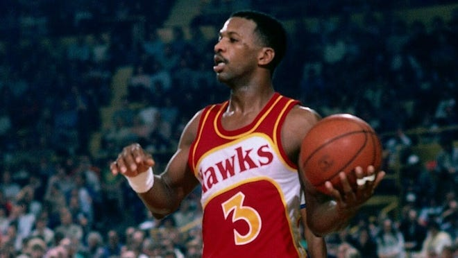 Eddie Johnson of the Atlanta Hawks looks to make a play against the Boston Celtics during a game played in 1985 at the Boston Garden in Boston, Massachusetts.  The former Lake Weir basketball star died Oct. 26, 2020, leaving behind a complicated legacy.