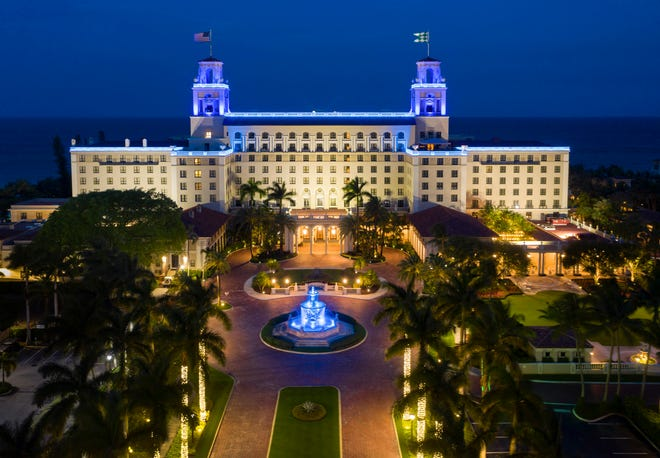 The Breakers Palm Beach lights up blue April 19 in honor of first responders and front-line workers during the COVID-19 pandemic. The hotel is hosting its first large scale event since the beginning of the pandemic.  [GREG LOVETT / PALM BEACH DAILY NEWS