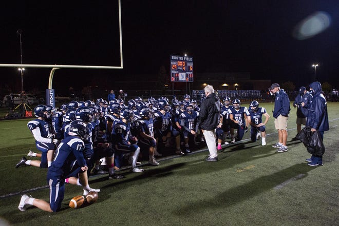 Exeter High School football coach Bill Ball speaks to his players following their home game against Spaulding on Oct. 16. The Blue Hawks were preparing to play a quarterfinal playoff game at Winnacunnet this weekend before halting their season due a positive case of COVID-19.