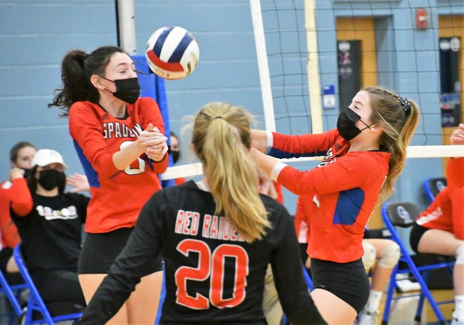 Spaulding's Ambra Breakfield, left, and Grace Beaulieu converge on a free ball as teammate Kylyn McLaren (20) looks on Thursday night.