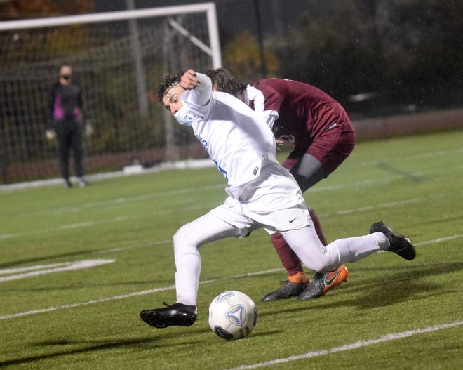 Winnacunnet High School midfielder Ryan Murray competes for the ball during a Division I playoff game against Portsmouth. The Warriors are bound for the state championship game for the first time in program history.