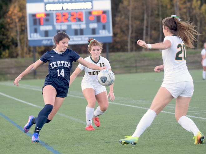 Exeter High School senior Ella Fraser (14) and the Blue Hawks are one win away from the program's ninth state championship in 15 years.
