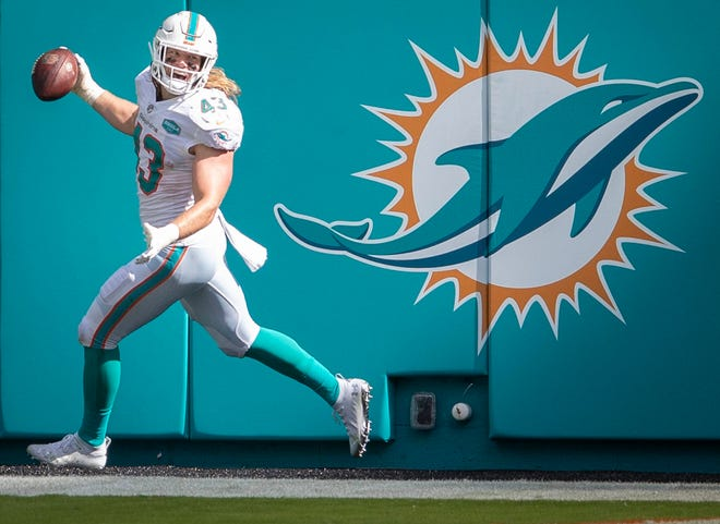Dolphins linebacker Andrew Van Ginkel returns a fumble 78 yards for a touchdown against the Rams.