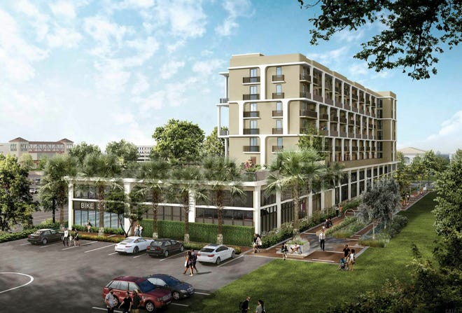 Flagler Station, an apartment building targeted for the downtown workforce, will include a linear neighborhood park along an historic rail spur behind it.