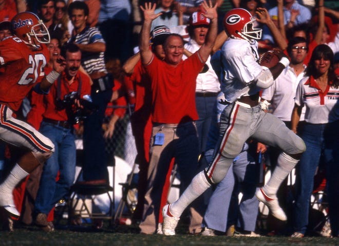 Georgia receiver Lindsay Scott runs down the Gator Bowl sideline during his game-winning 93-yard touchdown catch against Florida on Nov. 8, 1980.