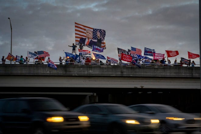 Trump supporters cheer from the top of the I95 overpass on Okeechobee Blvd. in  West Palm Beach, Florida on November 5, 2020.