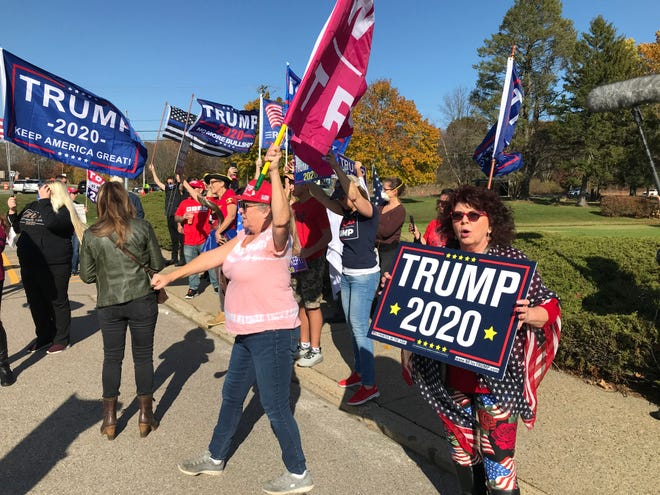 About 100 Trump supporters rally outside the Board of Elections in Cranston on Friday.