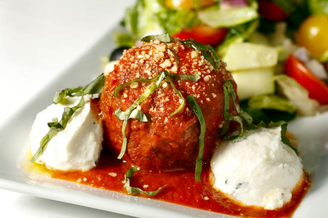 Meatball Salad is the signature dish at the new Jerry Longo's Meatballs and Martinis. A large homemade meatball is served  alongside a Longo salad with scoops of ricotta.