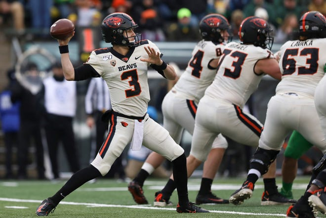 Tristan Gebbia (3), seen here in last year's game at Oregon, will start at quarterback for Oregon State in Saturday's season opener against Washington State.