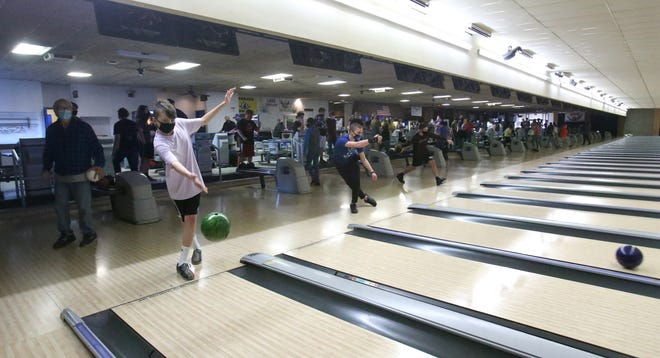 Area bowling teams practice at Park Centre Lanes in Jackson Township earlier this month.