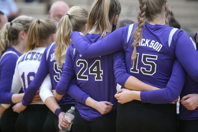 The Jackson volleyball team huddles during last year's Division I regional semifinal match against Nordonia.