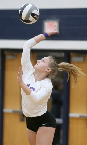 Jaidan Hockman of Jackson serves during their Division I regional semi final against Nordonia at Hudson on Thursday, Nov. 5, 2020.