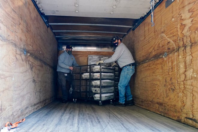 Election workers in Pennsylvania unload ballots.