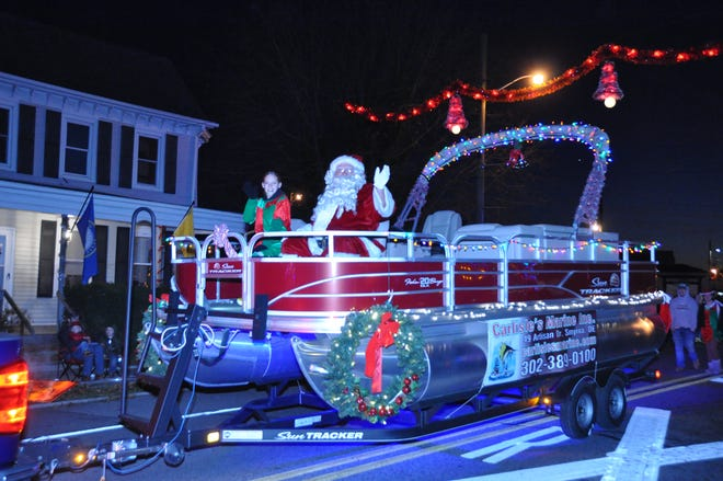 """Santa waves to spectators during the 2019 Christmas parade on Main Street in Clayton. This year's event has been changed to a """"reverse parade"""" at Smyrna High School Sunday, Dec. 6."""