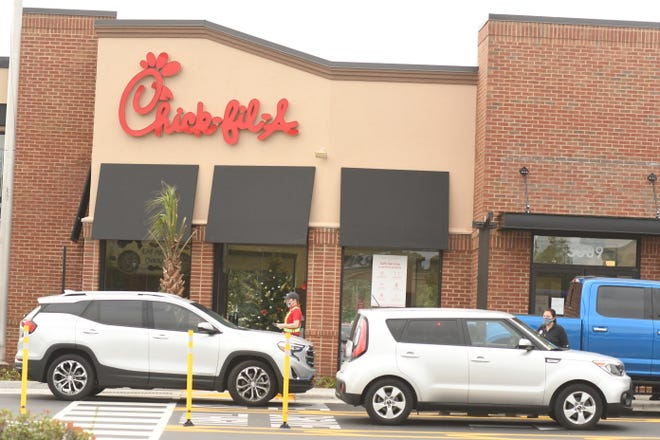 Customers go through the new drive through lanes at the Chick-fil-A store in Hanover Center Friday Nov. 6, 2020 after renovations were completed this week. The inside of the Chick-fil-A remains closed to diners due to concerns over COVID-19. [KEN BLEVINS/STARNEWS]