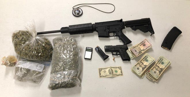 Firearms, money and drugs that were obtained when detectives executed a narcotics search warrant in Burgaw.
