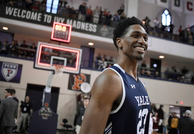 Yale's Jordan Bruner celebrates his team's win over Harvard at the end of an NCAA college basketball game for the Ivy League championship at Yale University in New Haven, Conn., Sunday, March 17, 2019, in New Haven, Conn. (AP Photo/Jessica Hill)