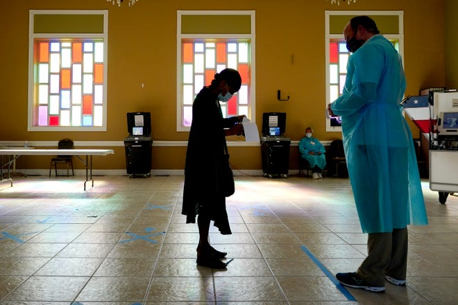 A woman waits to vote at the Cathedral of Praise church on Election Day in Nashville, Tenn.