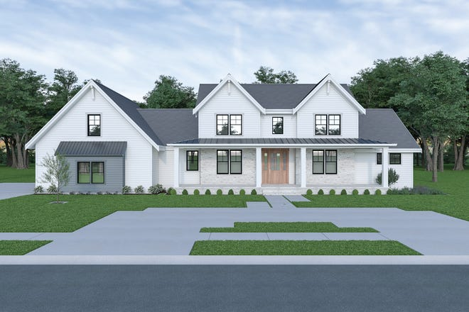Farmhouse curb appeal is front and center with metal roof accents, a wide front porch, and lots of windows.