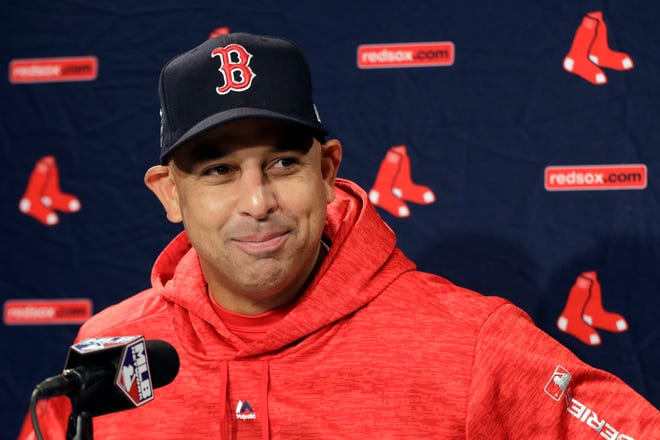 The Red Sox rehired Alex Cora as manager Friday, less than a year after letting him go because of his role in the Houston Astros cheating scandal.