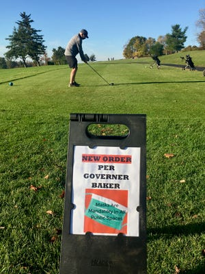 This sign awaited golfers at Green Hill's first tee on Friday.