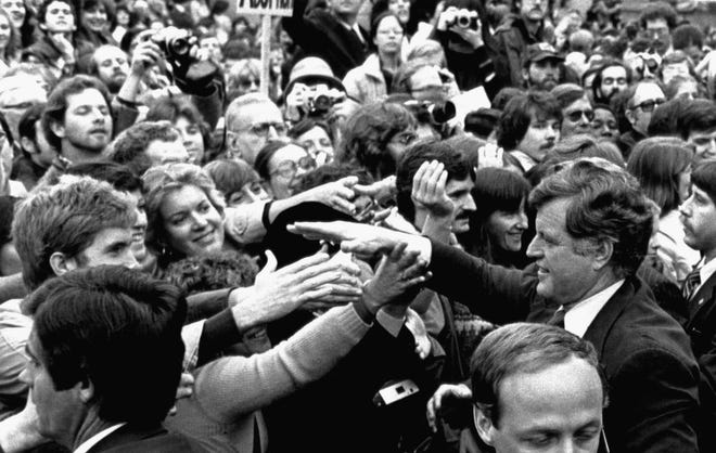 Sen. Edward M. Kennedy, lower right, shakes hands with spectators on Nov. 7, 1979, outside Boston's Faneuil Hall, where he announced he is challenging President JImmy Carter for the 1980 Democratic presidential nomination.