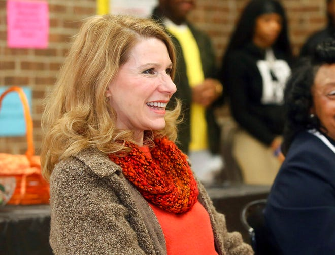 """FILE - In this March 4, 2019 file photo, Kristin Cooper, first lady of North Carolina, laughs as she responds to a question from a North Edgecombe High School student while visiting the high school as a part of National School Breakfast Week in Leggett, N.C. Cooper apologized Thursday, Nov. 5, 2020,  through an emailed statement from her spokesperson to The News & Observer after a screenshot of her saying she """"flipped off"""" supporters of President Donald Trump during a rally in the state was circulated on social media. (Alan Campbell/Rocky Mount Telegram via AP)"""
