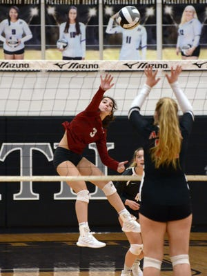 Dover's Taylor Luneborg goes up for a kill during a Division II regional semifinal loss to Plain City Jonathan Alder on Thursday at Pickerington North.