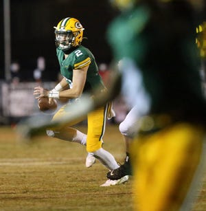Gordo quarterback Tanner Bailey (2) rolls out and looks to pass against Brooks at Pickens County High School in Reform Thursday, Nov. 5, 2020.  [Staff Photo/Gary Cosby Jr.]